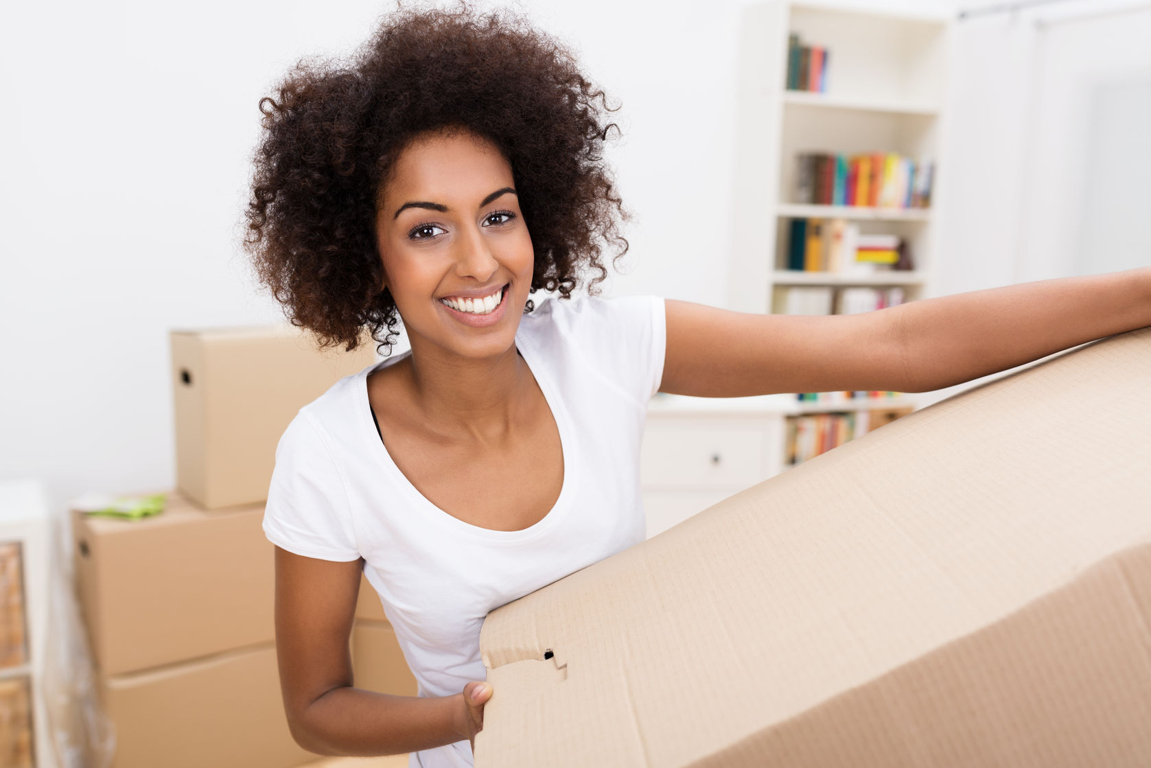 Woman carrying boxes moving house