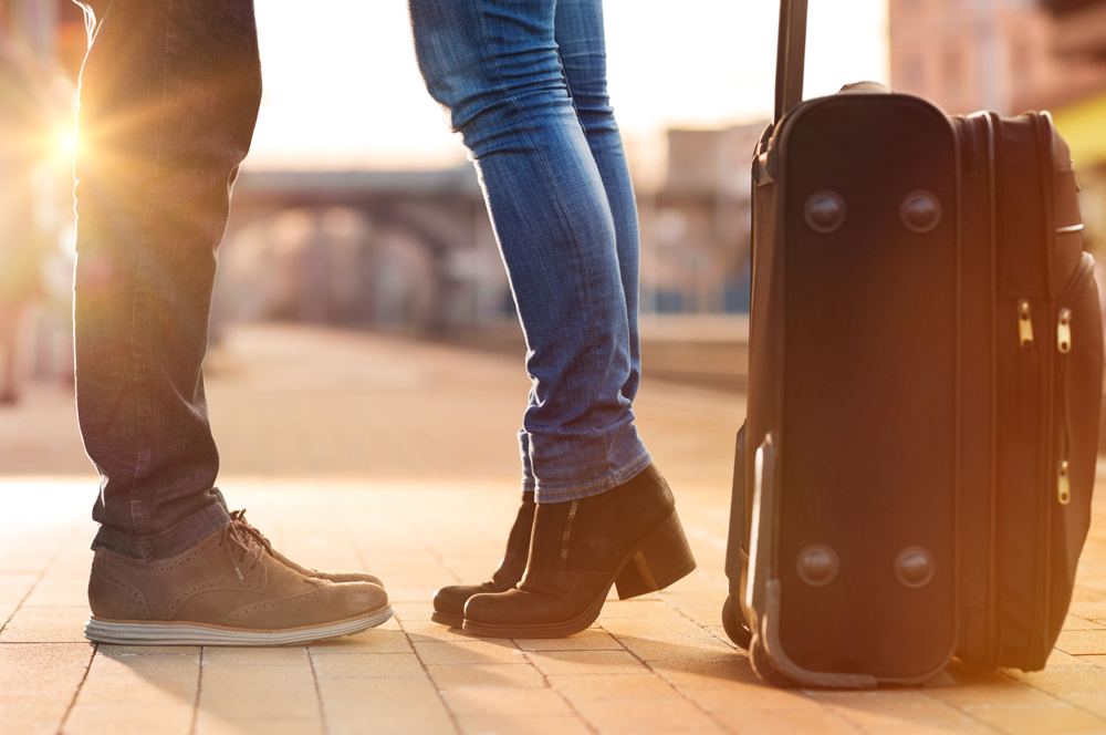 Couple meeting with suitcase