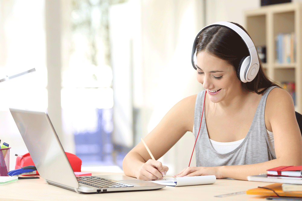 Female student studying with headphones